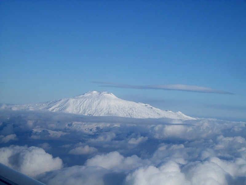 Snow-clad Etna among the clouds